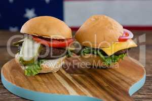 Burgers on wooden table with 4th july theme