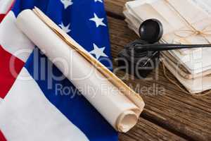 American flag with rolled-up of constitution document