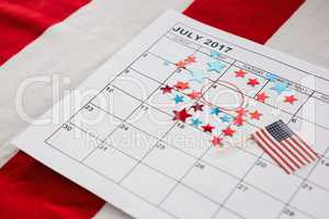 Calendar marked with star shape decoration and American flag