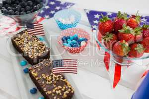 Close-up of sweet food and strawberries decorated with 4th july theme