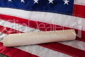 Rolled-up document arranged on American flag