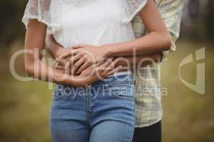 Mid section of couple embracing