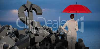 Composite image of rear view of businesswoman carrying red umbrella
