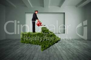 Composite image of businesswoman using red watering can