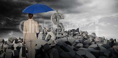 Composite image of rear view of businesswoman carrying blue umbrella
