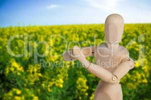 Composite image of wooden 3d figurine performing yoga