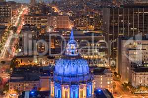 Aerial View of San Francisco City Hall at Night with Golden State Warriors Colors.