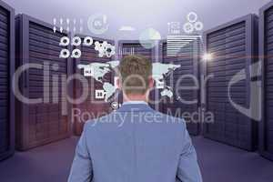 Businessman is standing on from the back against data center background