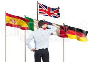main language flags behind businessman backwards