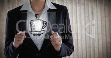 Business woman mid section with glass device behind coffee graphic with flare against blurry wood pa