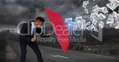 Digital image of businessman defencing documents with red umbrella while standing on road against cl