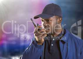 Security guard with walkie talkie against blurry wall with building sketch and flare