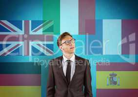main language flags with opacity around young businessman. Blue background