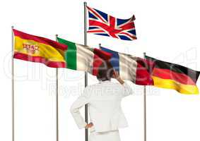main language flags behind businesswoman backwards