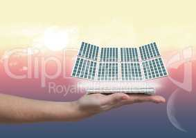 solar panel on hand with night and day background
