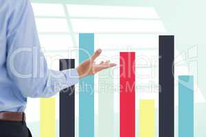 Part of businessman in front of different graphics