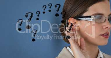 Businesswoman hearing gossip against blue background