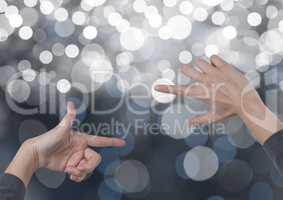 Hands  creating rectangle invisible shape with sparkling light bokeh background