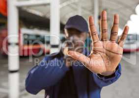 security guard saying stop with his hand in the bus station