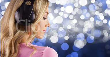 Blond-hair girl listenning music with headphones back to the photo with blue background