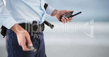 security guard with walkie-talkie and cuffs. blurred back
