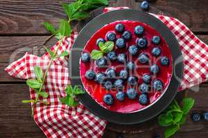 Blueberry cake with fresh berries and marmalade, cheesecake