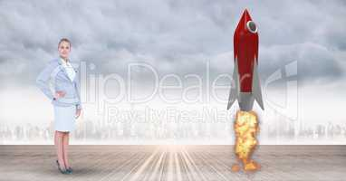 Digital composite image of businesswoman standing by rocket launch against city