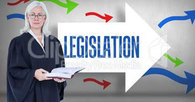 Digital composite image of female lawyer holding book while  standing against legislation text on ar