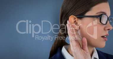 Businesswoman listening gossip against blue background