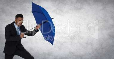 Business man blocking with umbrella against white background and grunge overlay