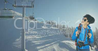 Hiker looking at ski lift while standing on snow covered mountain