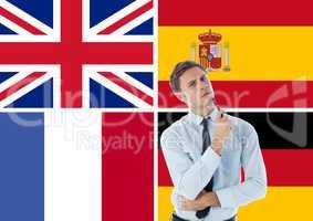 main language flags around thoughtful man