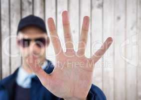 security guard whit his hand up saying stop. white wood