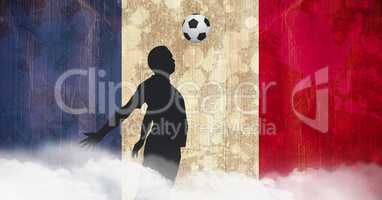 Shadow of a footballer playing in front of french flag