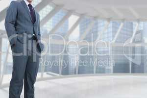 Part of businessman standing on in empty building