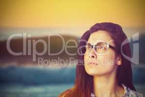 Composite image of close up of thoughtful woman wearing eyeglasses