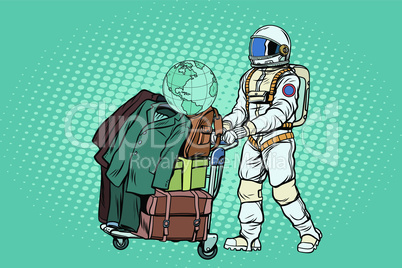 Astronaut traveler with baggage cart
