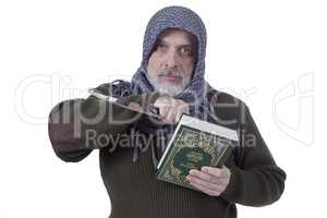Muslim man with a Koran and a knife