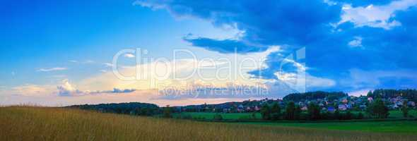 Meadow and sunset sky