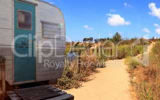 Small retro caravan camper used as a tiny house on road trips