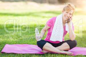 Young Fit Adult Woman Outdoors with Towel and Water Bottle on Yo