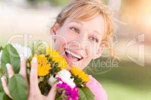 Outdoor Portrait of an Excited Young Adult Brown Eyed Woman Hold