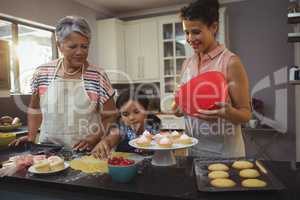 Happy family preparing desserts in kitchen