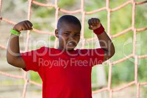 Boy standing in the boot camp during obstacle course training