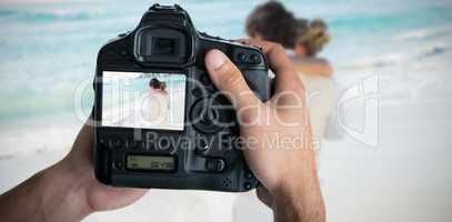 Composite image of cropped image of hands holding camera