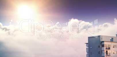 Composite image of tranquil scene of bright sun over cloudscape