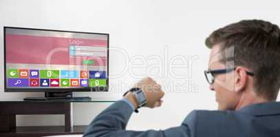 Composite image of rear view of businessman checking his smart watch