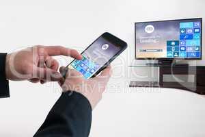 Composite image of businessman using smart phone