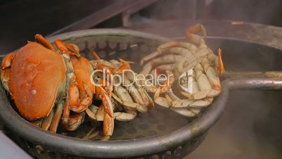 Crab boiling in a big pan.