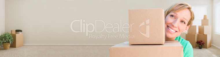 Banner of Happy Young Adult Woman Holding Moving Boxes In Empty